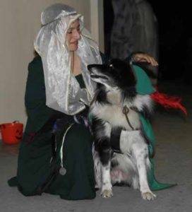 Stacy and her dog Flip dressed as Maid Marion and Robin Hood